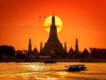 Wat Arun at Sunset from the River Bangkok, Thailand